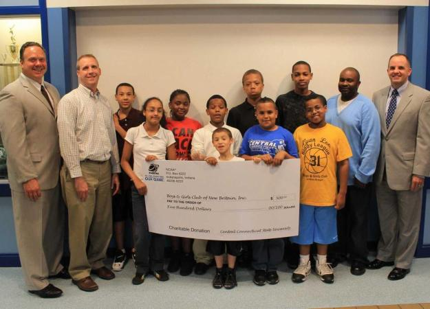 Paul Schlickmann and Steve Villanti present a check for $500 to the Boys and Girls Club of New Britain.