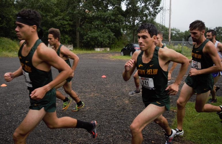 The Delhi men run to the win at Hartwick.