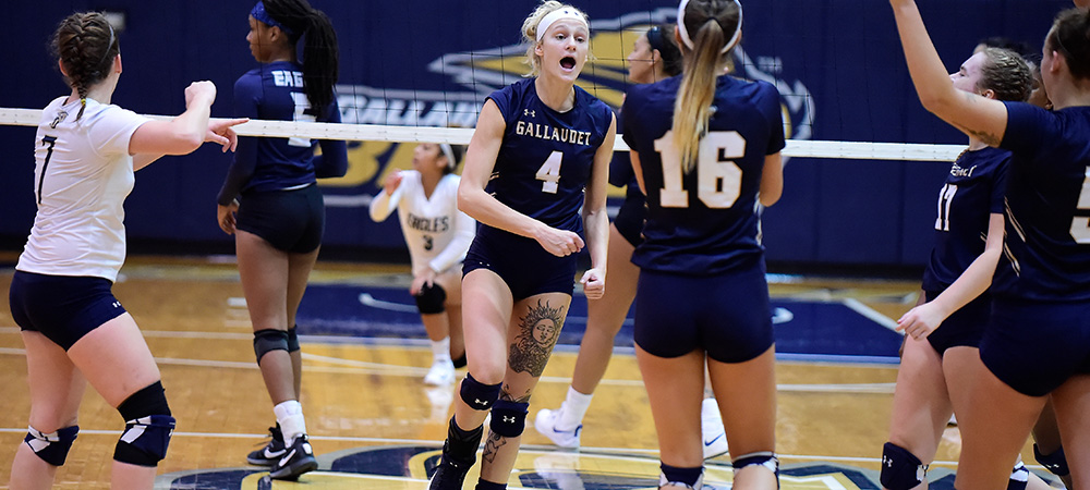 GU's Tessa Lewis celebrates a point in a women's volleyball match with her teammates.