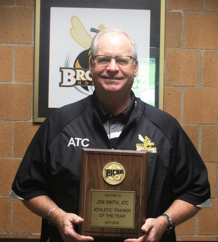 Athletic Trainer holding NJCAA Region III Athletic Trainer of the Year plaque