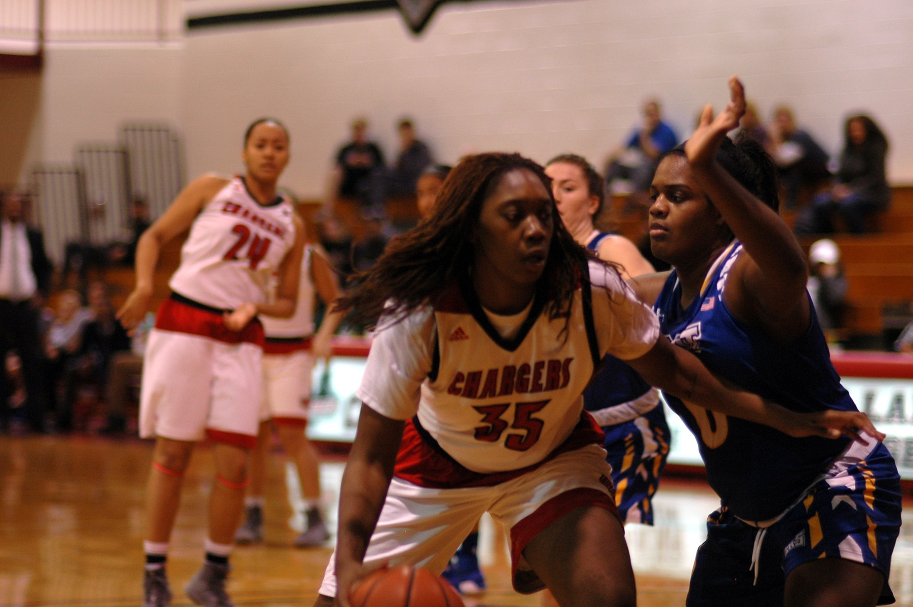 LADY CHARGERS VICTORIOUS OVER QUEENS COLLEGE KNIGHTS
