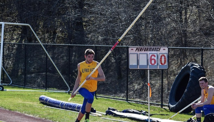 Tim Berry races down runway prior to pole vault attempt