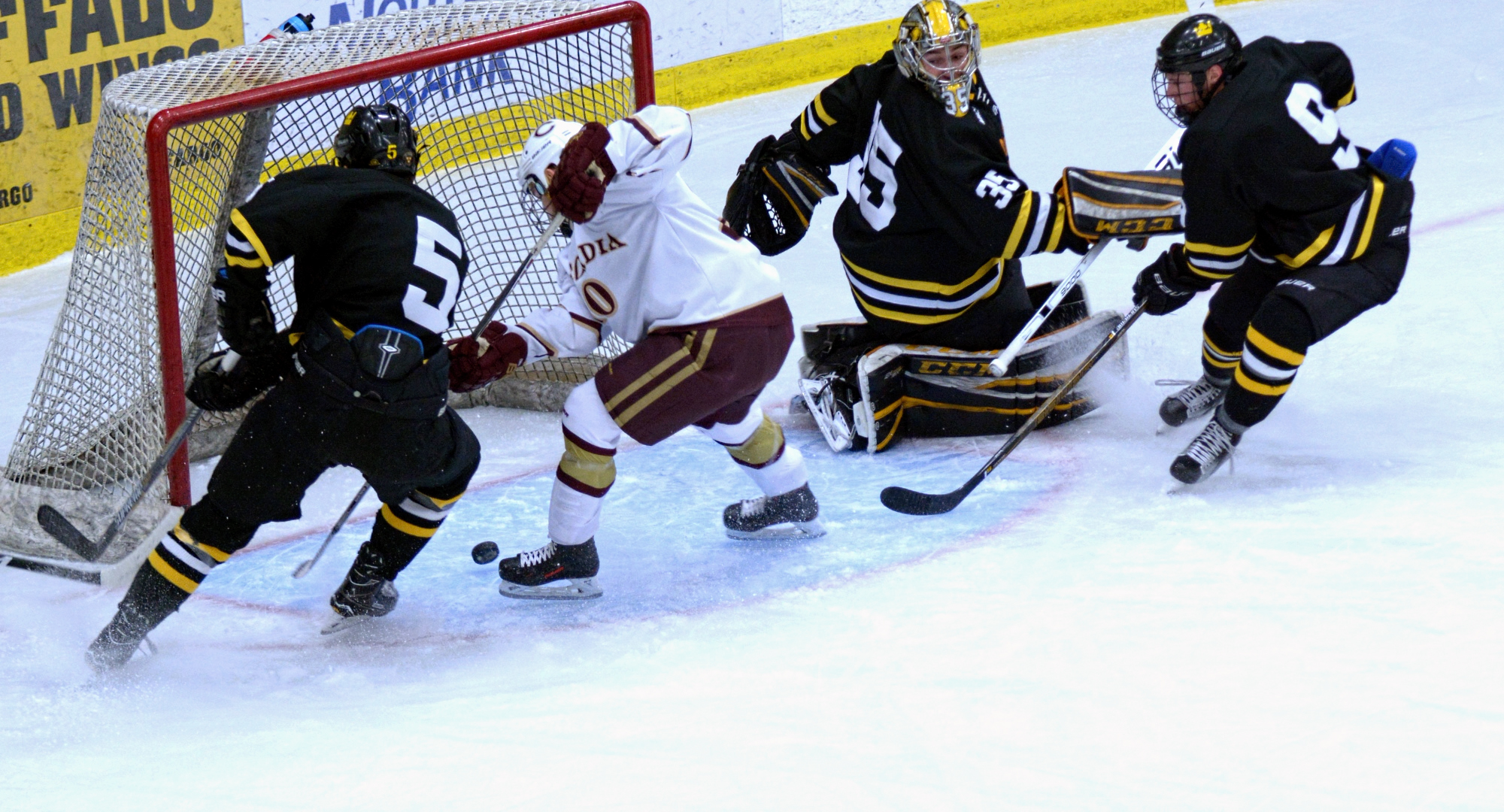 Senior Jeremy Johnson has the puck carom off his skate and into the net for the game-winning goal in the Cobbers' series opener with Gustavus.