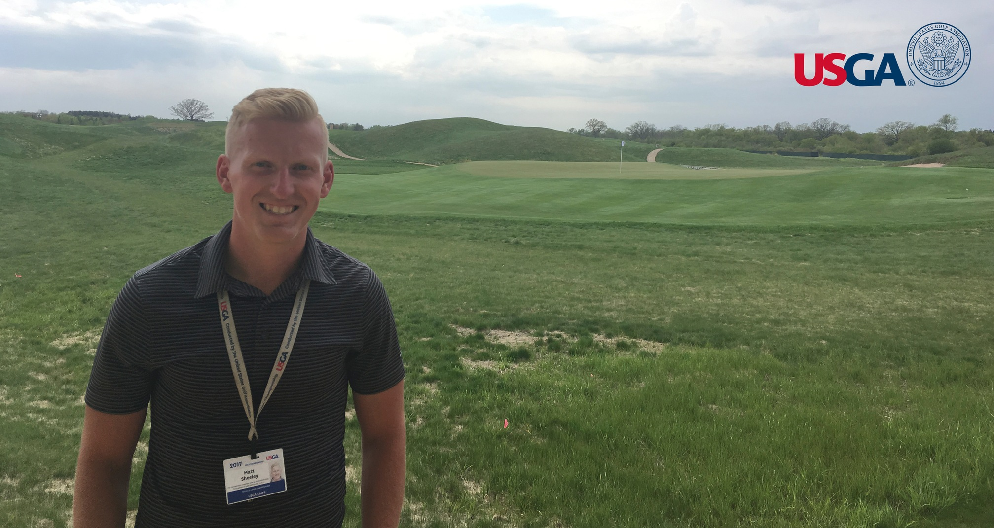 Sheeley (pictured) in front of the 13th green at Erin Hills, site of the 117th U.S. Open Championship.