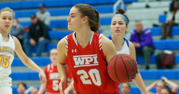 WPI female basketball player dribbling.