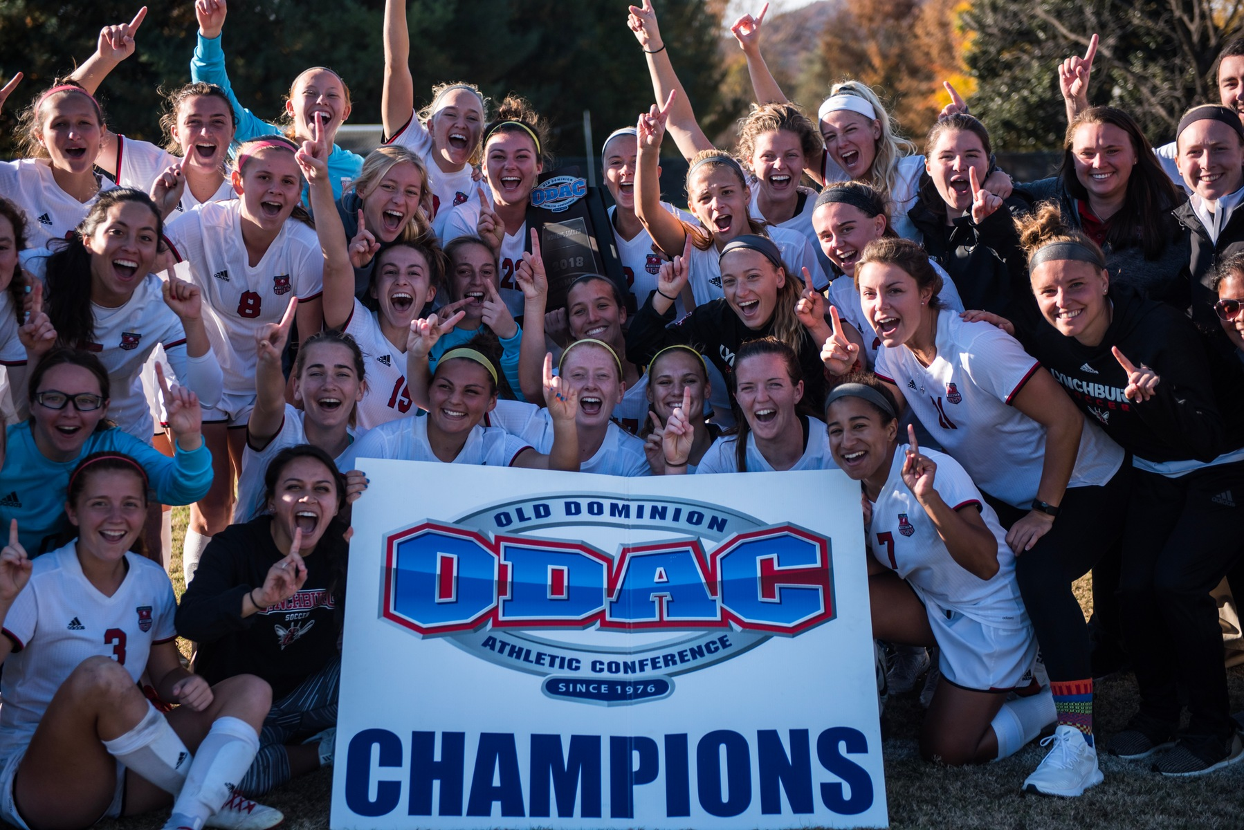 Lynchburg women's soccer celebrating an ODAC championship.