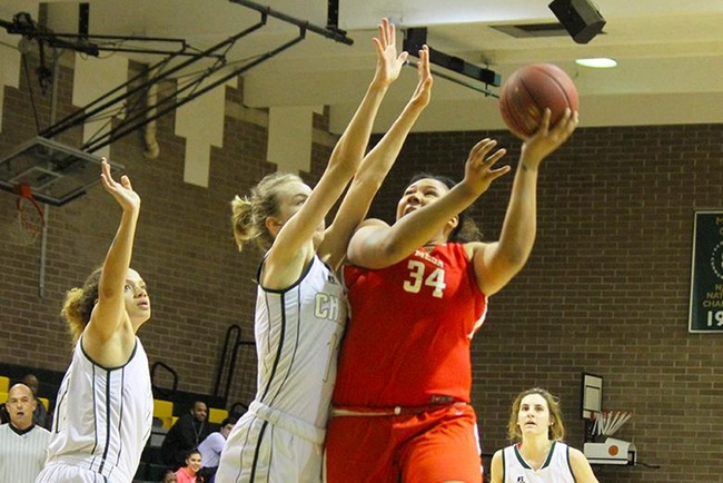 Paige Nealey (#34) scores two of her six points over Scottsdale defenders Wednesday night. (photo by Aaron Webster)