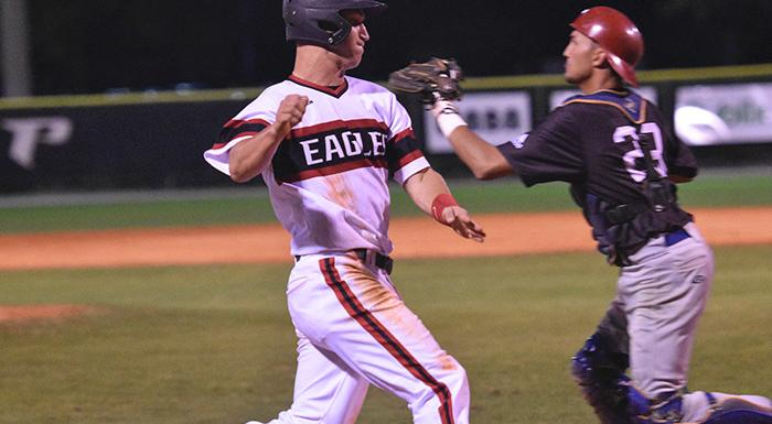 Zach Scott scores from first base on Jonah Garrison's two-out double. (Photo by Tom Hagerty, Polk State.)