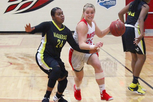 Courtney Colleary drives to the hoop against a Central Arizona defender Wednesday night. (Photo by A-a-ron Webster)