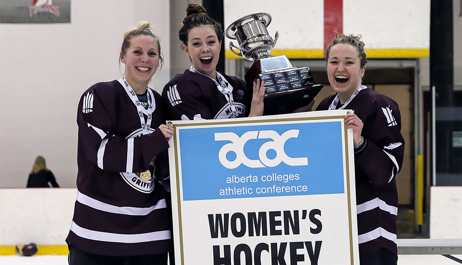 Griffins Courtney Zajac, left, Sydney Thomlison and Shanya Shwetz celebrate the 2016-17 ACAC women's hockey championship last March. On Oct. 6, before their 2017-18 home opener, MacEwan University will hold a special ceremony honouring their accomplishment (Nick Kuiper photo).