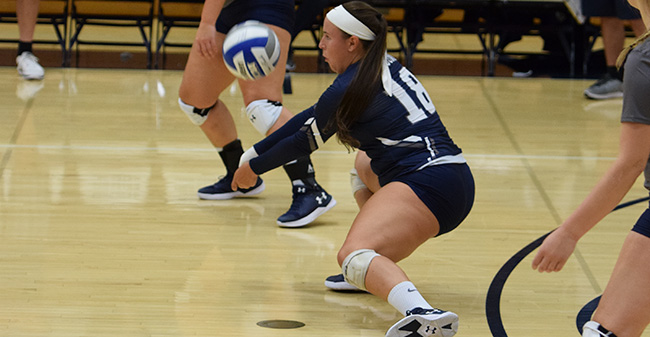 Jean Markovic '18 digs a ball against York College of Pennsylvania.