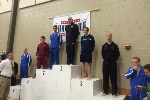 Morgan Richter receives his gold medal after winning the 200 Fly