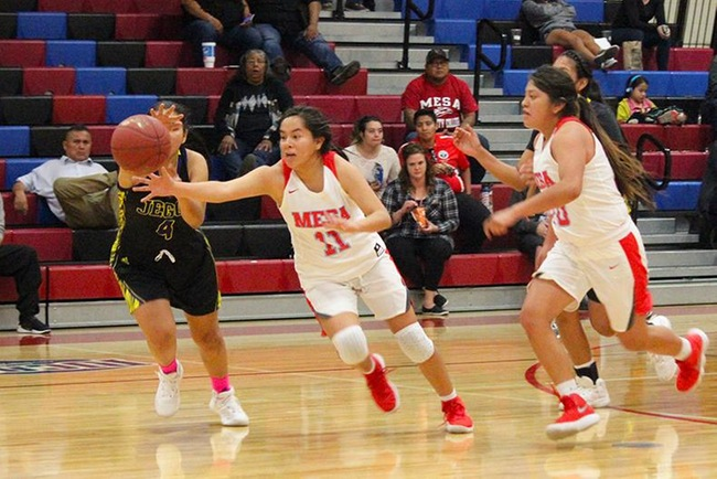 Lynnae Mitchell (#11) attacks a Jego loose ball in Wednesday night's win over Tohono O'Odham.