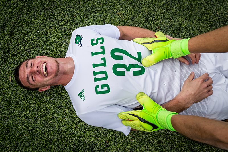 A soccer student-athlete smiles.