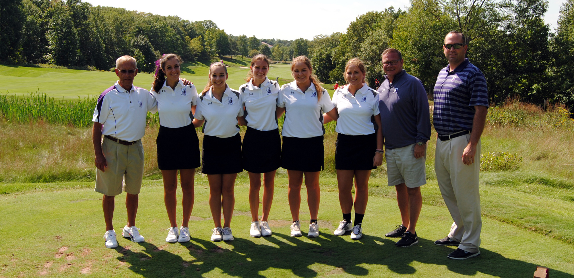 The first women's golf match in University of Scranton history was played on Tuesday. Pictured, from left, are head coach Ed Karpovich, Katie Allen, Brianna Stein, Julie Cranney, Maggie McDonough, Maura McDonough, director of athletics Dave Martin, and assistant coach Trevor Woodruff.