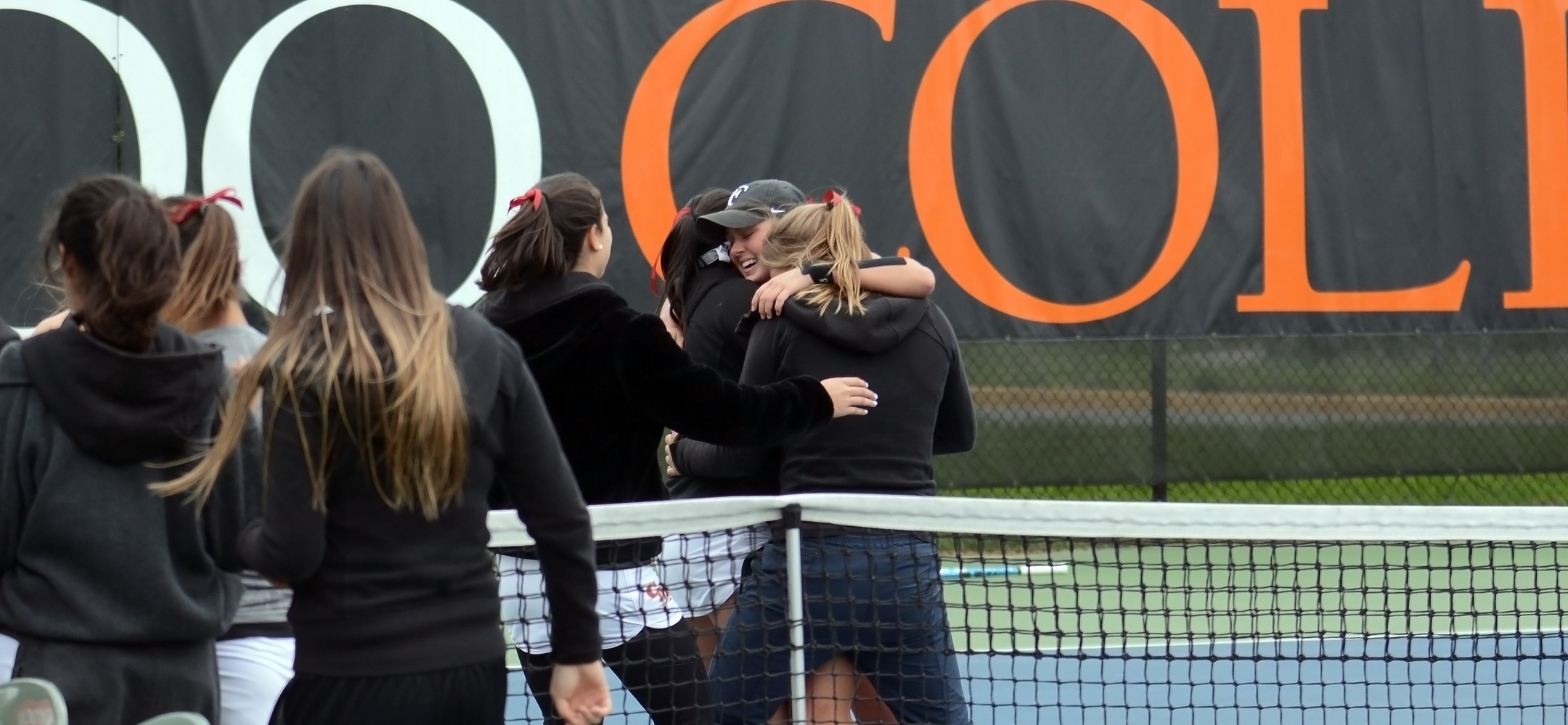 Caroline Cox is congratulated by her teammates after the clinching win that sent CMS on to the finals