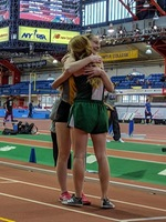 Veronica Dailey receives a hug from fellow competitor Grace Galligan (Franciscan University)