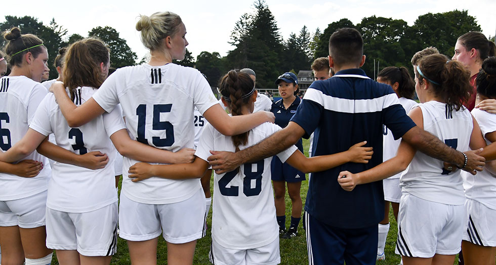 Members of the 2016 Mount Holyoke soccer team in a pregame huddle.