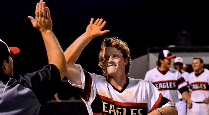 Sam Machonis celebrates after hitting a walkoff home run to give Polk State a 4-1 win tonight.