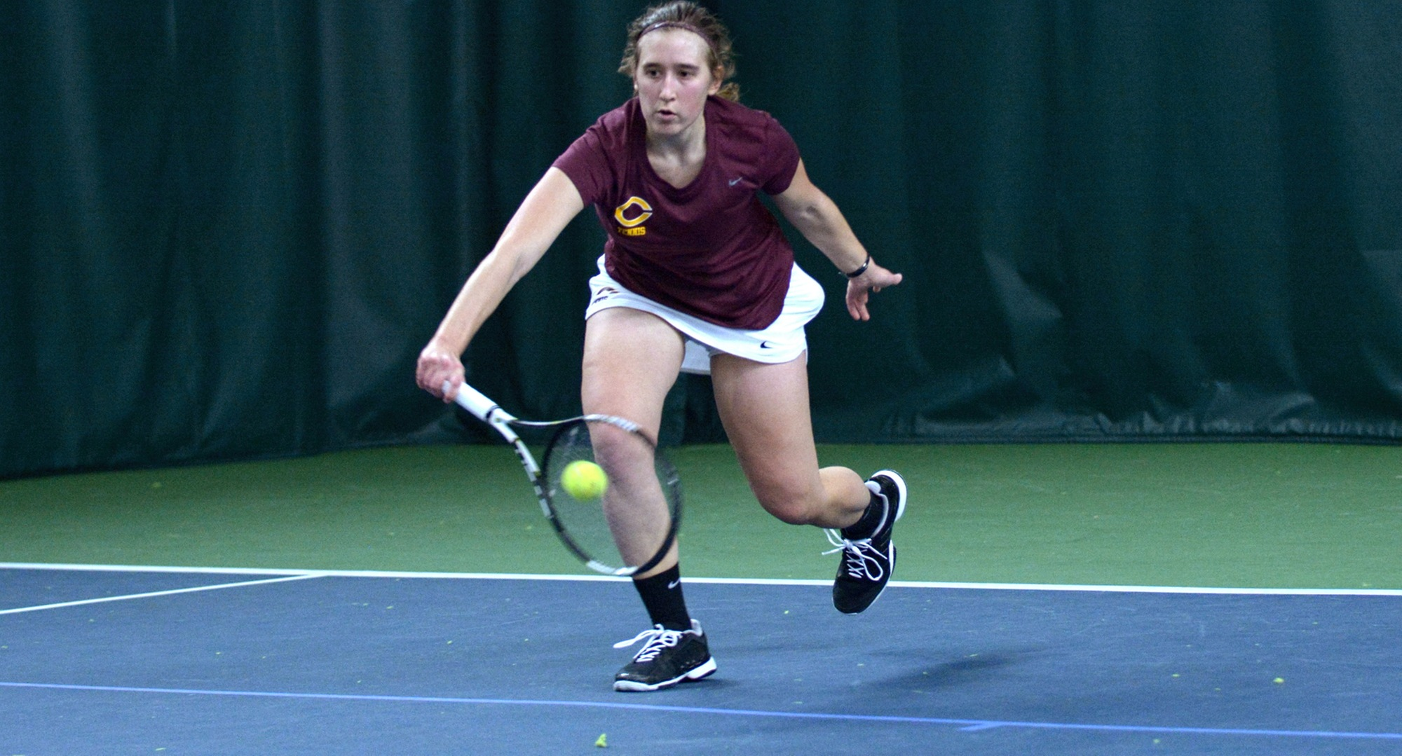 Sophomore Lisa Neumann goes down to return a shot during her 6-1, 6-0 win at No.2 singles in the Cobbers' season opener.
