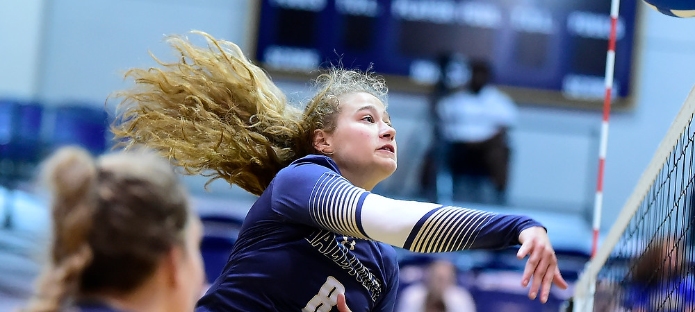 Gallaudet women's volleyball player Cassidy Perry makes an attack in a match in the Field House.