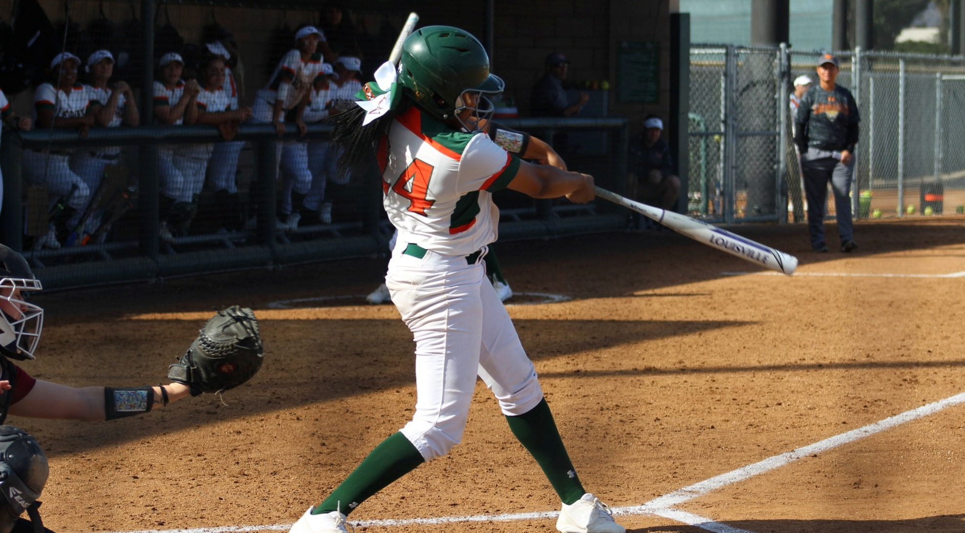 Softball sweeps Oxy, takes command of first place