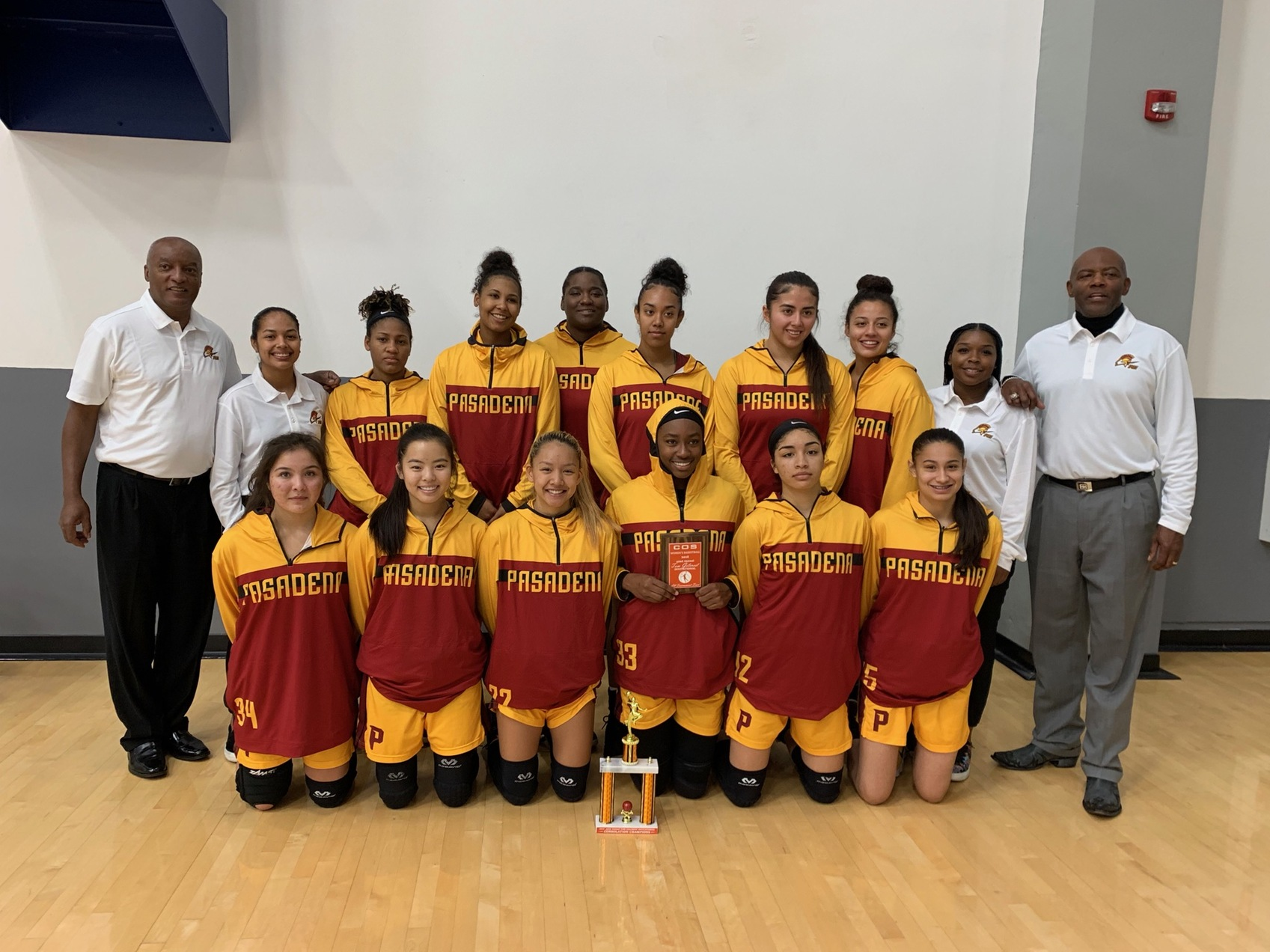 The PCC women's basketball squad takes a team shot following their consolation title at the College of the Sequoias tournament.