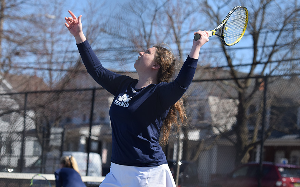 Sophomore Kristen Cassidy serves in a match versus Elizabethtown College at Hoffman Courts.