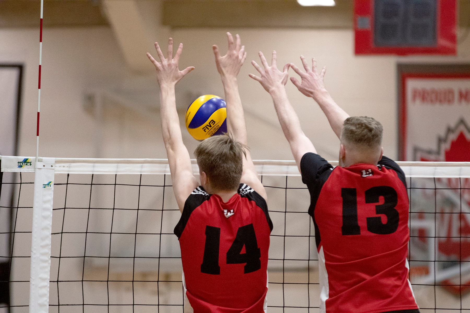 Wesmen Liam Kristjanson (left) and Ethan Duncan team up to get a block on a Calgary attack during a men's volleyball match Friday, Feb. 7, 2020 at the Duckworth Centre. (David Larkins/Wesmen Athletics)