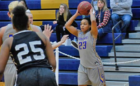 Rosalyn Sealey looks to pass the basketball