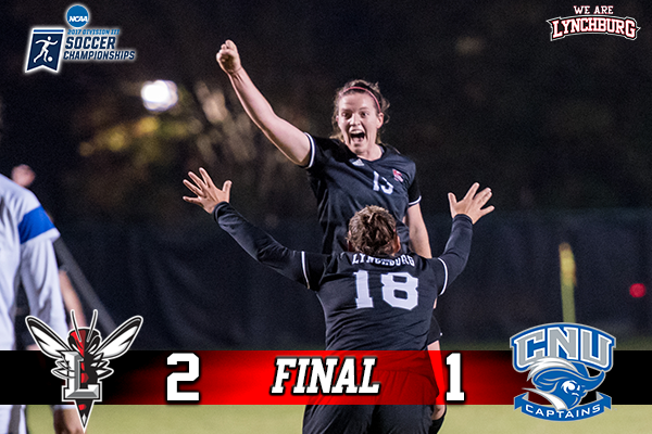 Rachel Cooke celebrates a Lynchburg goal with her arm in the air.