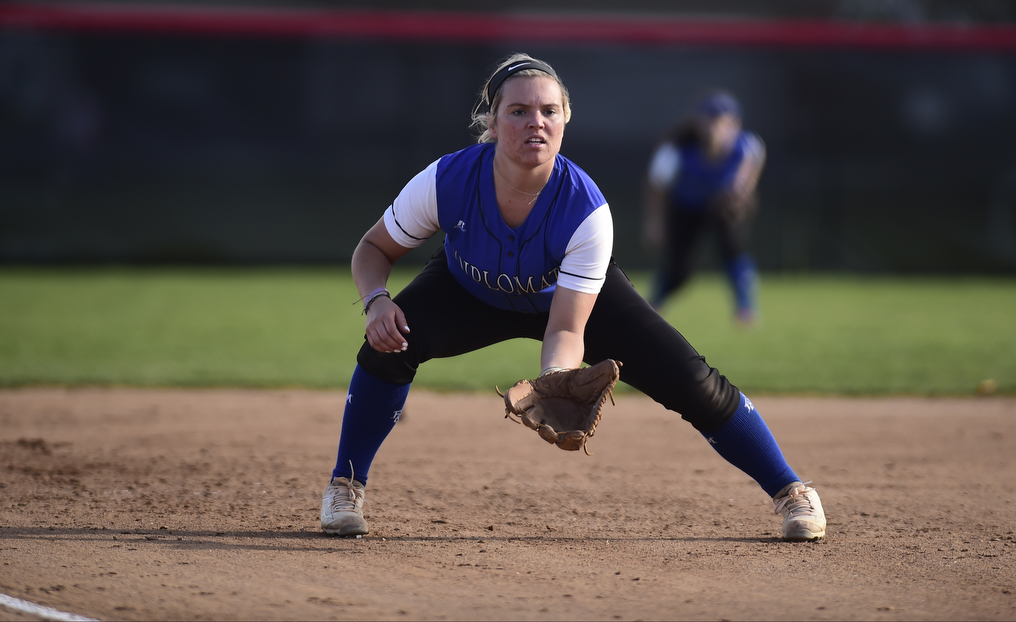 Softball Splits Fourth Day of Action