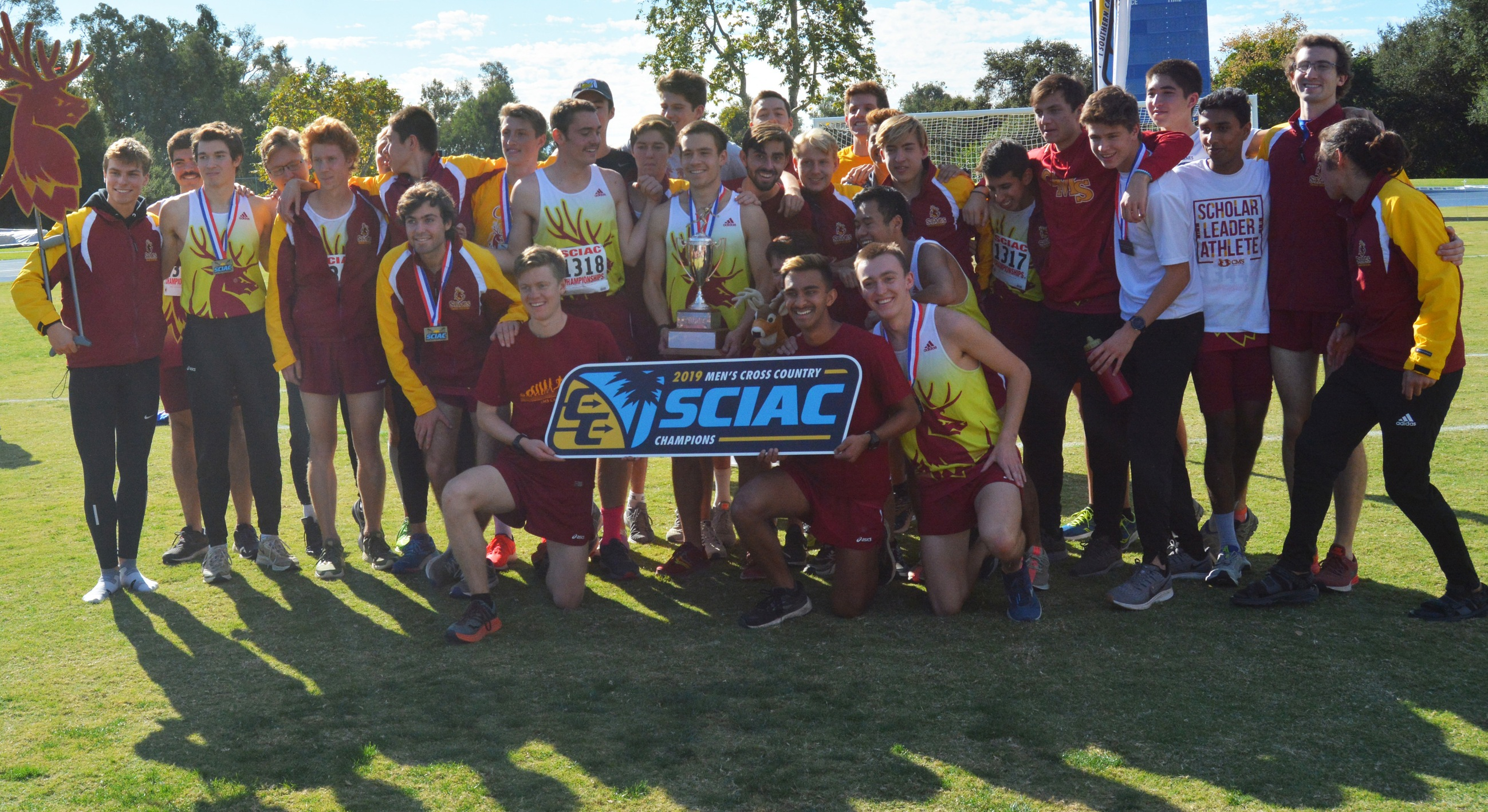 CMS men's cross country celebrating the SCIAC title