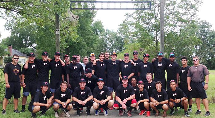 Eagles players and coaches pose for a group photo while camping.