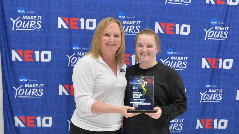 Mary Huminski receives the Most Outstanding Diver Award from NE10 Commissioner Julie Ruppert