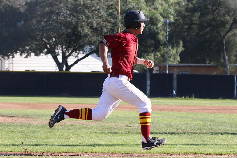 Andres Kim scores one of the team's 66 runs thus far in six wins, photo by Richard Quinton.