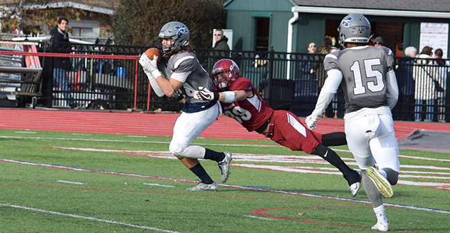 Nick Zambelli '19 intercepts a pass early in the third quarter at Muhlenberg College.