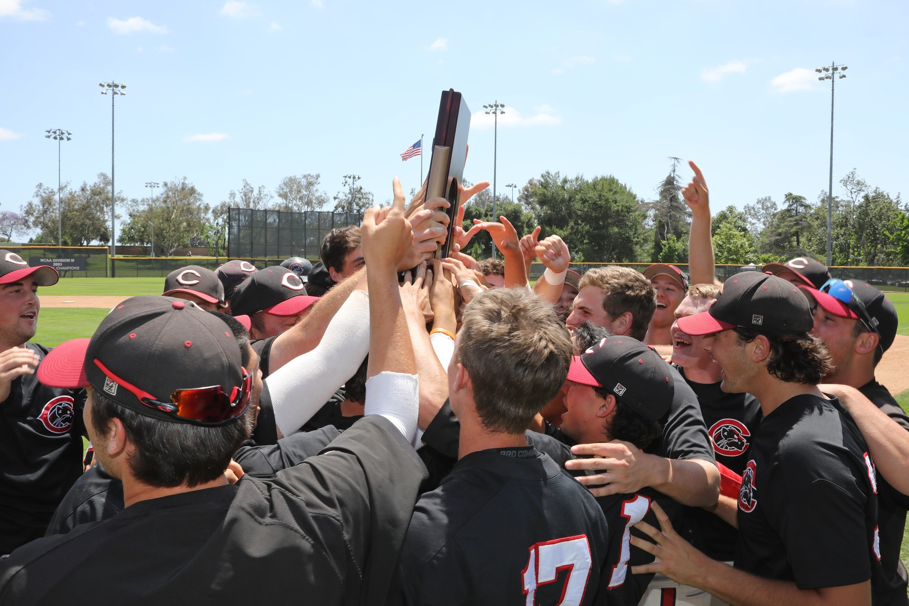 The Chapman baseball team holds up the Super Regional trophy.