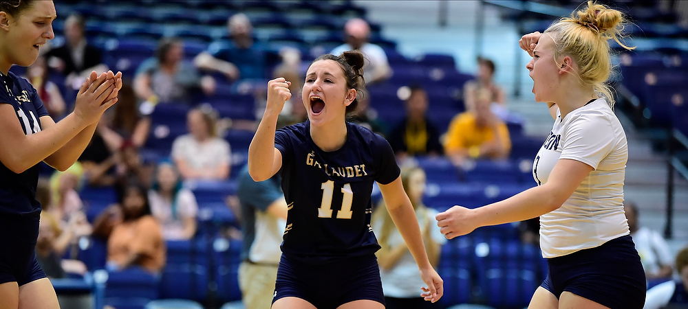 GU women's volleyball player Demi Bingham is excited after the Bison scored a point in a match.