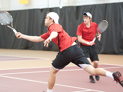 FSU's Justin Hermes (foreground) was a winner in singles play at Northwood