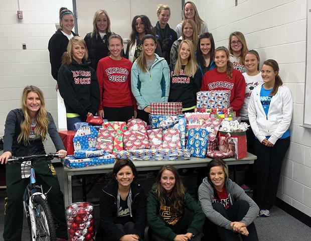 The Express women's soccer team, pictured here with the gifts they bought, adopted a local family for Christmas. It was the second consecutive year they've worked with the United Way on this project. Photo by Owens Sports Information