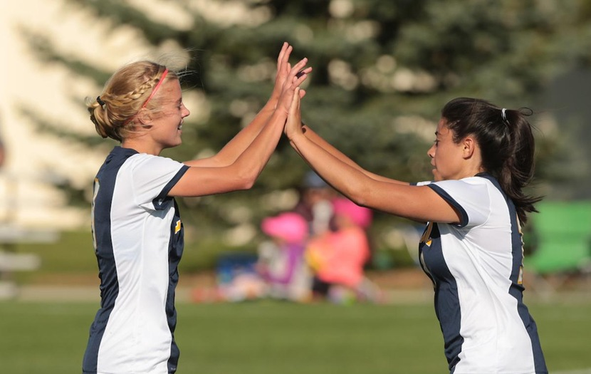 Elise Atkins and Abby Morillon celebrate after a goal