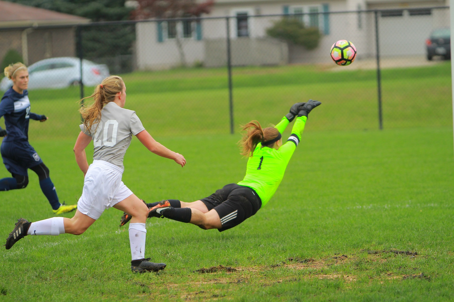 Faith goalie Lyndi Shepard dives for a save against Maranatha