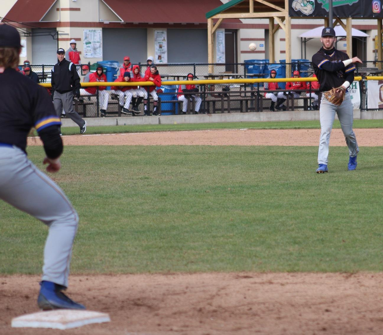 NIACC shortstop Jake Hansen throws to first baseman Jake Hansen for an out in Saturday's game against DMACC.