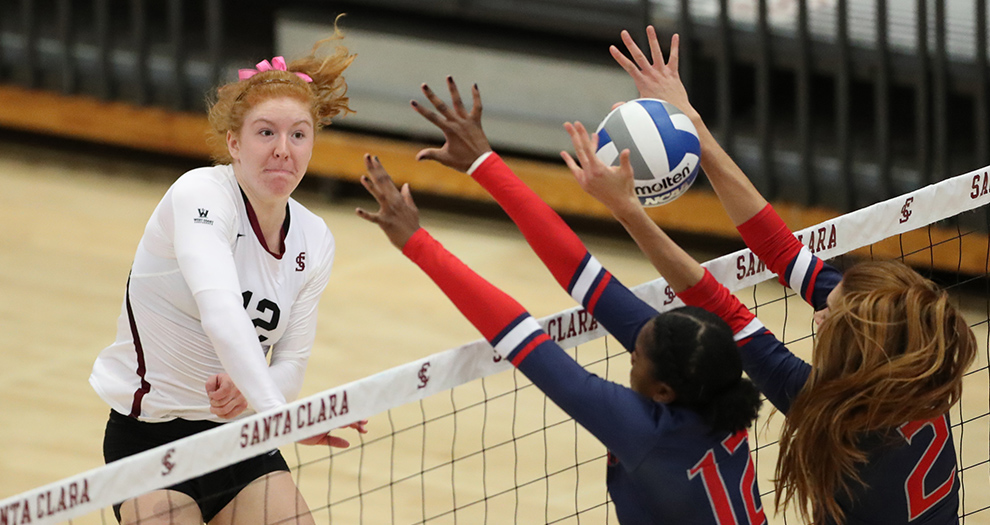 Chloe Loreen tools the block in a five-set victory over Saint Mary's on Saturday, Oct. 21 in Leavey Center. The freshman outside hitter logged her fourth straight double-double in the victory.