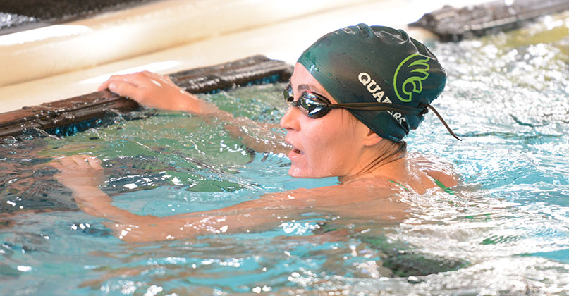 Leon leads Fightin' Quakers women's swimming in double dual