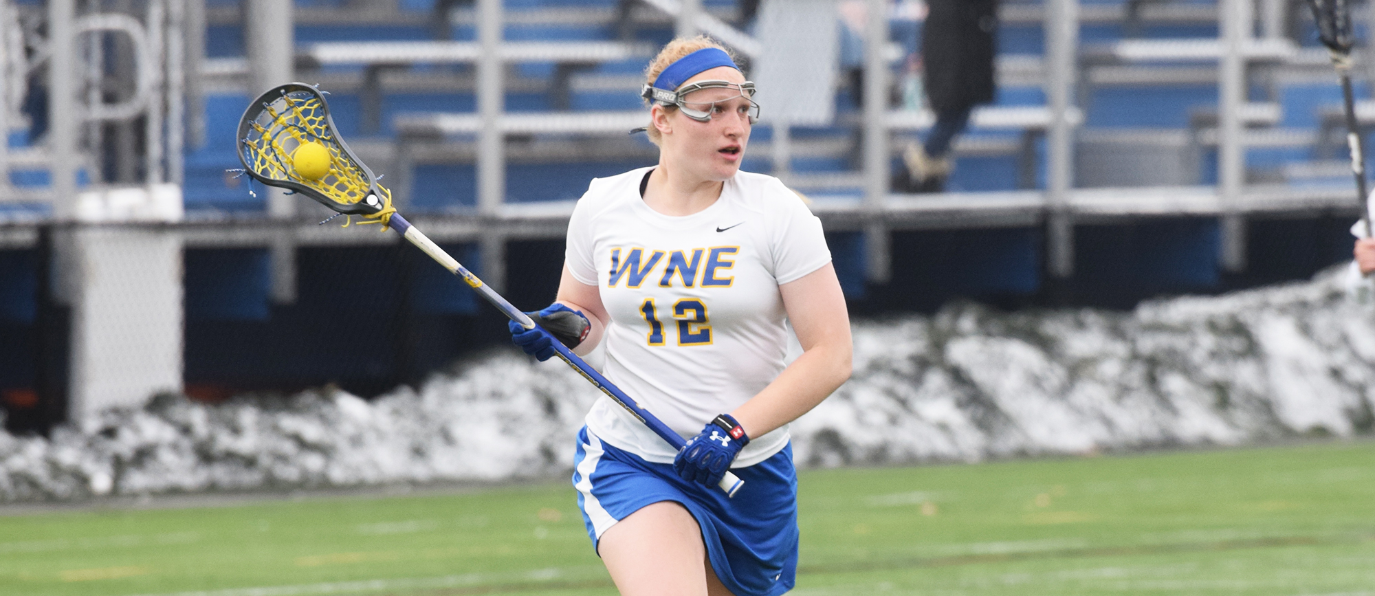 Junior Rebecca Allen recorded four draw controls, two assists and two ground balls in Western New England's 11-4 loss at UNE on Saturday. (Photo by Rachael Margossian)