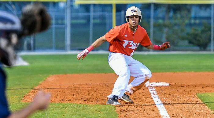 Demetrio Rodriguez takes a lead off third base against Warner University JV. He had two hits, three stolen bases, and three RBI in a 12-5 win. (Photo by Tom Hagerty, Polk State.)