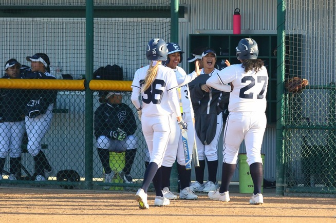 File Photo: Teammates greet Briana Lopez (27), who homered and drove in three runs against Compton