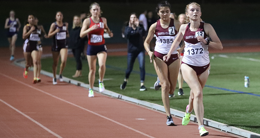 Allison Martinez (far right) and Marisa Sanchez (bib 1385) are two of seven women's runners in the 3,000-meter race on Saturday night.